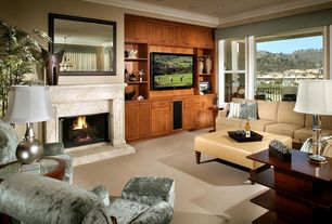 Traditional Living Room with Built-in bookshelf, Cement fireplace, Crown molding, Carpet