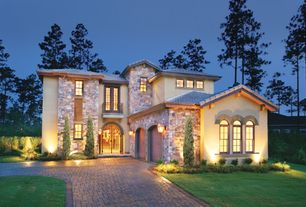 Contemporary Exterior of Home with Arched double entry door, Tile roof, Exterior cladding, Exterior lighting