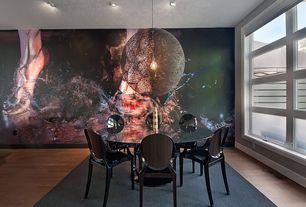 Contemporary Dining Room with interior wallpaper, Hardwood floors, Pendant light