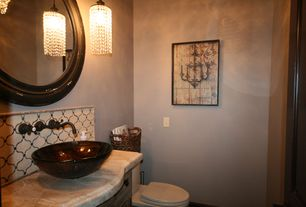 Mediterranean Powder Room with Pendant light, Elite neutral handcrafted glass bowl vessel bathroom sink, Raised panel, Flush