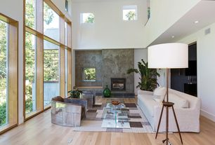 Contemporary Living Room with stone fireplace, Fireplace, Loft, Hardwood floors, can lights, picture window, Window seat