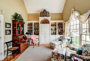 Traditional Living Room with High ceiling, specialty door, Built-in bookshelf, Arched window, Hardwood floors
