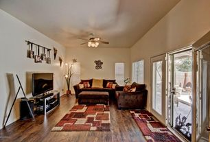 Traditional Living Room with French doors, Hardwood floors, Ceiling fan