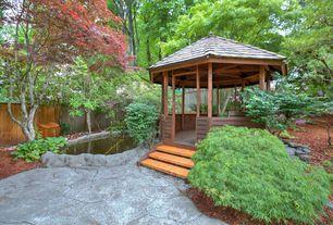 Traditional Landscape/Yard with Gazebo, Pathway, Fence, exterior stone floors, Pond