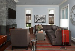 Contemporary Living Room with can lights, French doors, Hardwood floors, Crown molding, Standard height, Fireplace