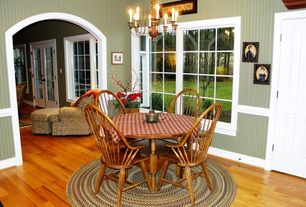 Country Dining Room with Hardwood floors, Chandelier, Chair rail
