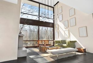 Contemporary Living Room with High ceiling, sliding glass door, picture window, limestone floors, Paint, Pendant light