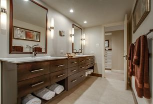 Transitional Master Bathroom with European Cabinets, Undermount sink, Wall sconce, Corian counters, specialty door