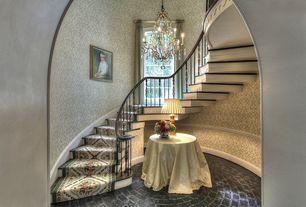 Traditional Staircase with Arch doorway, interior wallpaper, High ceiling, Chandelier, Hardwood floors, Brick interior floor