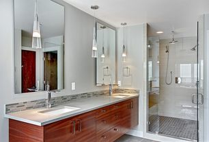 Contemporary 3/4 Bathroom with Handheld showerhead, Flush, Rain shower, Ceramic Tile, European Cabinets, Corian counters