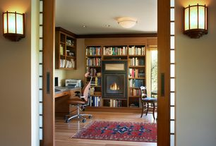 Craftsman Home Office with flush light, Hardwood floors, Built-in bookshelf, Crown molding, Wall sconce