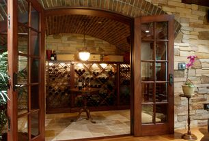 Traditional Wine Cellar with French doors, interior brick, Standard height, Pendant light, travertine floors