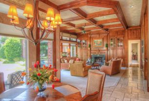 Traditional Great Room with French doors, stone fireplace, Box ceiling, Transom window, limestone tile floors, Ceiling fan