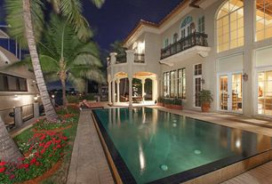 Mediterranean Swimming Pool with exterior tile floors, Lap pool, French doors, Arched window