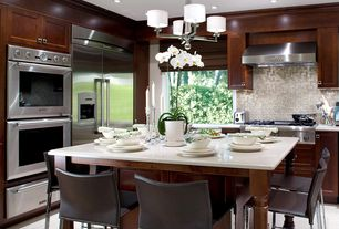 Contemporary Kitchen with full backsplash, can lights, Flat panel cabinets, Built In Refrigerator, double wall oven, L-shaped