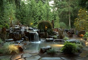 Rustic Landscape/Yard with exterior stone floors, Pond, Fountain