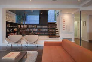 Contemporary Living Room with Built-in bookshelf, Hardwood floors, French doors, Columns, Shag area rug