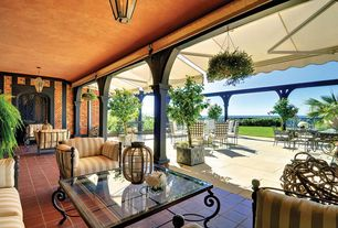 Traditional Porch with exterior terracotta tile floors, exterior awning, Arched window, Pathway, Screened porch