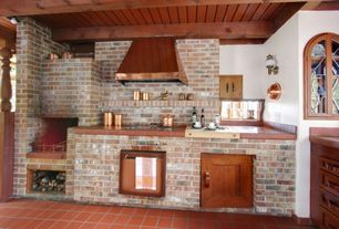 Rustic Kitchen with Standard height, Exposed beam, Wall sconce, Rustica House Copper Range Hood, terracotta tile floors