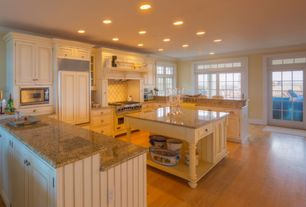 Cottage Kitchen with Built In Panel Ready Refrigerator, Standard height, full backsplash, Simple granite counters, can lights