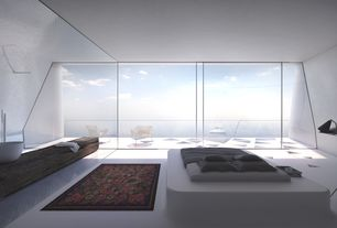 Contemporary Master Bedroom with Concrete floors, Built-in bookshelf, mesh silver chair