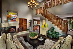 Contemporary Great Room with Fireplace, French doors, Loft, Thomas lighting chandelier aged bronze, Cement fireplace