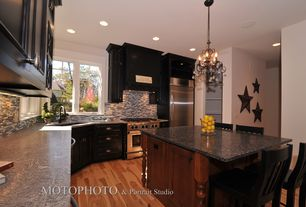 "Modern Kitchen with Angola black, Rustic Metal Star, 24"", Custom hood, Breakfast bar, Galley, Simple marble counters"