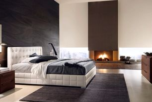 Contemporary Master Bedroom with Window seat, Concrete floors