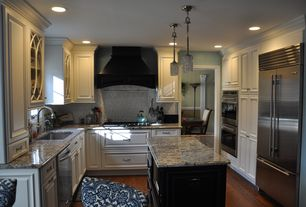 Traditional Kitchen with can lights, Kitchen island, Subway Tile, double wall oven, Pendant light, Custom hood, Glass panel