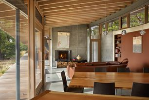 Contemporary Great Room with Cement fireplace, Exposed beam, Concrete floors, Pendant light, Bocci single pendant
