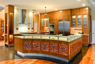 Contemporary Kitchen with Kitchen island, Pendant light, Soapstone counters, European Cabinets, Undermount sink, Glass panel