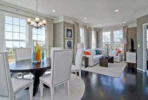 Contemporary Great Room with Makenzie three-piece sectional, Crown molding, can lights, double-hung window, Paint, Chandelier