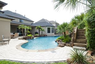 Tropical Swimming Pool with Other Pool Type, picture window, Outdoor kitchen, exterior stone floors, Raised beds, Fence
