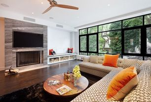 Contemporary Living Room with Hardwood floors, Ceiling fan, Window seat