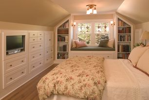 Traditional Guest Bedroom with Hardwood floors, Window seat, Standard height, double-hung window, Wall sconce, flush light