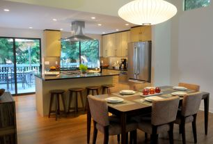 Contemporary Dining Room with Pendant light, Balcony, Breakfast bar, Glass Tile, French doors, Soapstone counters, L-shaped