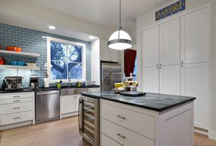 """Contemporary Kitchen with Wine refrigerator, """"Be Nice or Leave"""" Navy Sign, Flat panel cabinets, Kitchen island, L-shaped"""