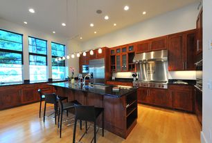 Contemporary Kitchen with Pendant light, Breakfast bar, L-shaped, Undermount sink, Soapstone counters, Flat panel cabinets
