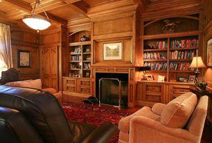 Traditional Living Room with Box ceiling, Built-in bookshelf, flush light, Fireplace, Hardwood floors, Standard height