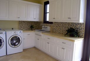 Traditional Laundry Room with limestone floors, Casement, Standard height, laundry sink, French doors, Built-in bookshelf