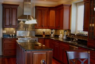 Traditional Kitchen with Casement, Simple granite counters, Undermount sink, full backsplash, Wall Hood, Framed Partial Panel