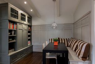 Craftsman Dining Room with Exposed beam, Wainscotting, Hardwood floors, Built-in bookshelf, Crown molding, Pendant light