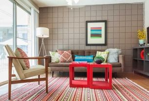 Contemporary Living Room with Ceiling fan, Rag area rug, Brown point lounge accent chair, Chrome 3-legged floor lamp