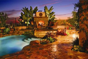 Tropical Swimming Pool with Raised beds, exterior stone floors, Other Pool Type, outdoor pizza oven, Fence