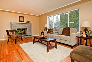 Traditional Living Room with Hardwood floors, stone fireplace, Crown molding