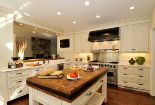 Contemporary Kitchen with can lights, Custom hood, Maple cherry solid hardwood flooring, partial backsplash, Farmhouse sink