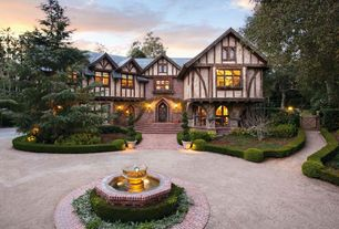 Traditional Exterior of Home with Roundabout driveway, Water feature