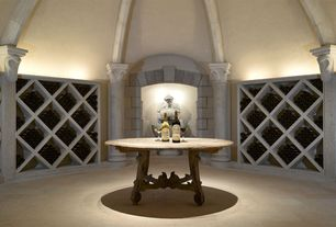 Mediterranean Wine Cellar with sandstone floors, Built-in bookshelf, Standard height, Exposed beam, Columns