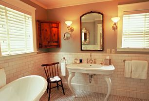 Traditional Full Bathroom with Master bathroom, ceramic tile floors, Console sink, Bathtub, Wall sconce, Casement