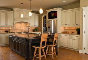 Traditional Kitchen with specialty door, Dura Supreme Cabinetry Wilmington Panel, Stone Tile, Custom hood, L-shaped